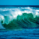 blue and green waves crashing at the ocean