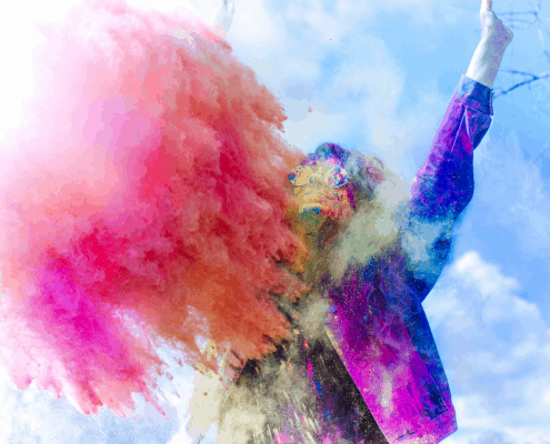 woman with brightly colored powder around her